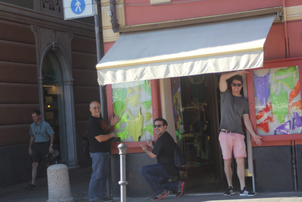 Cheeky lads shopping for a cheeky number for a dip in Santa Margherita